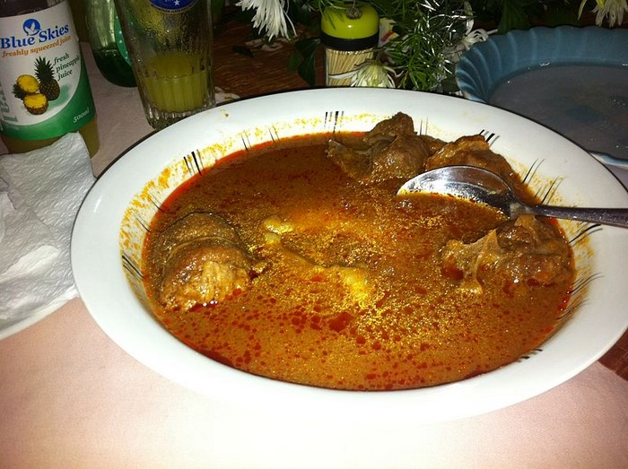 Fufu in a light tomato soup with goat. By sshreeves (Creative Commons)