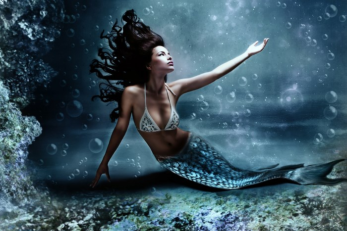 Dark haired, blue-eyed mermaid. Bigstock.