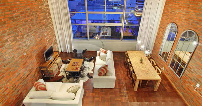 Mountain View Loft features large windows and spectacular city views | Photo: TravelGround