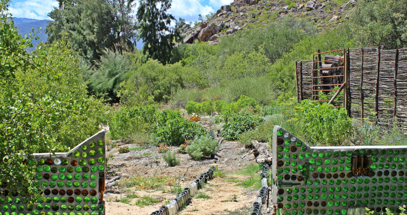 The glass enclosure around the vegetable garden.