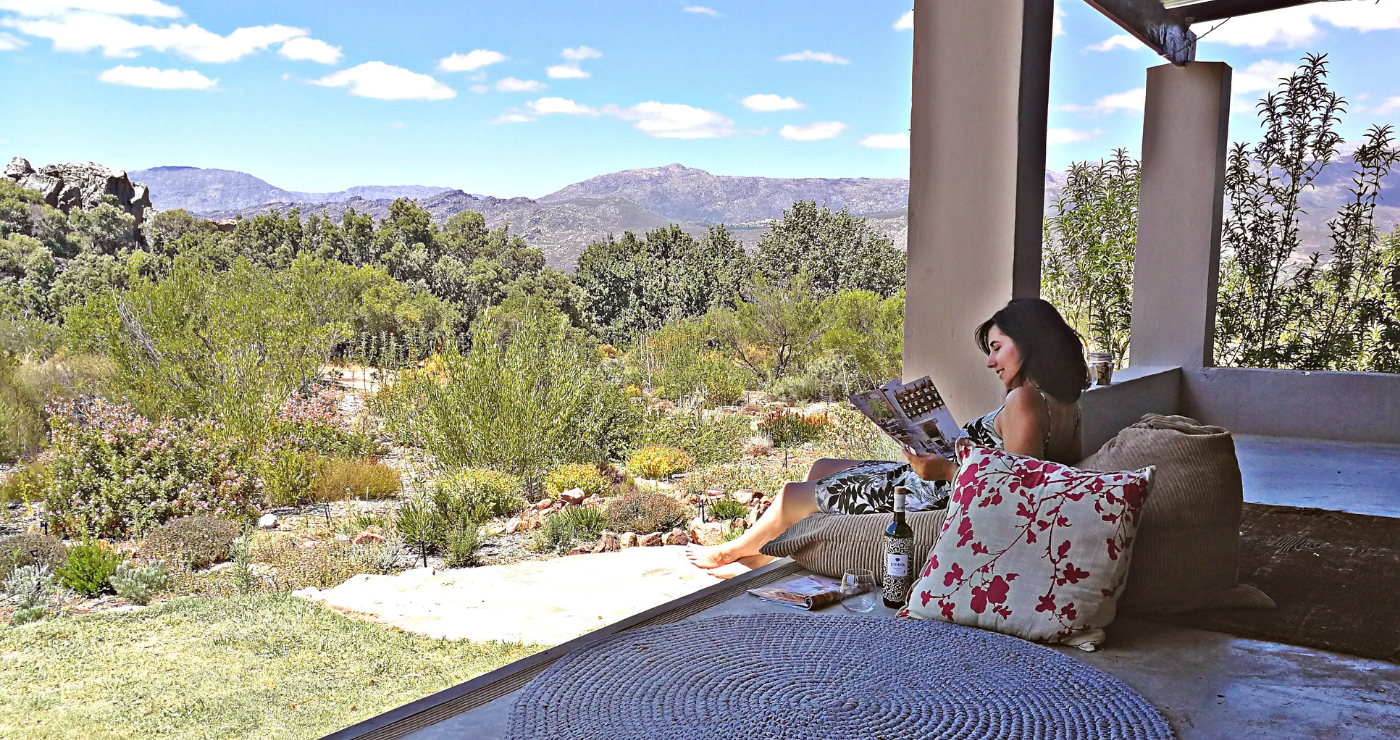 Lazing on the stoep, looking out over the fynbos garden is a favourite activity at Cederkloof.