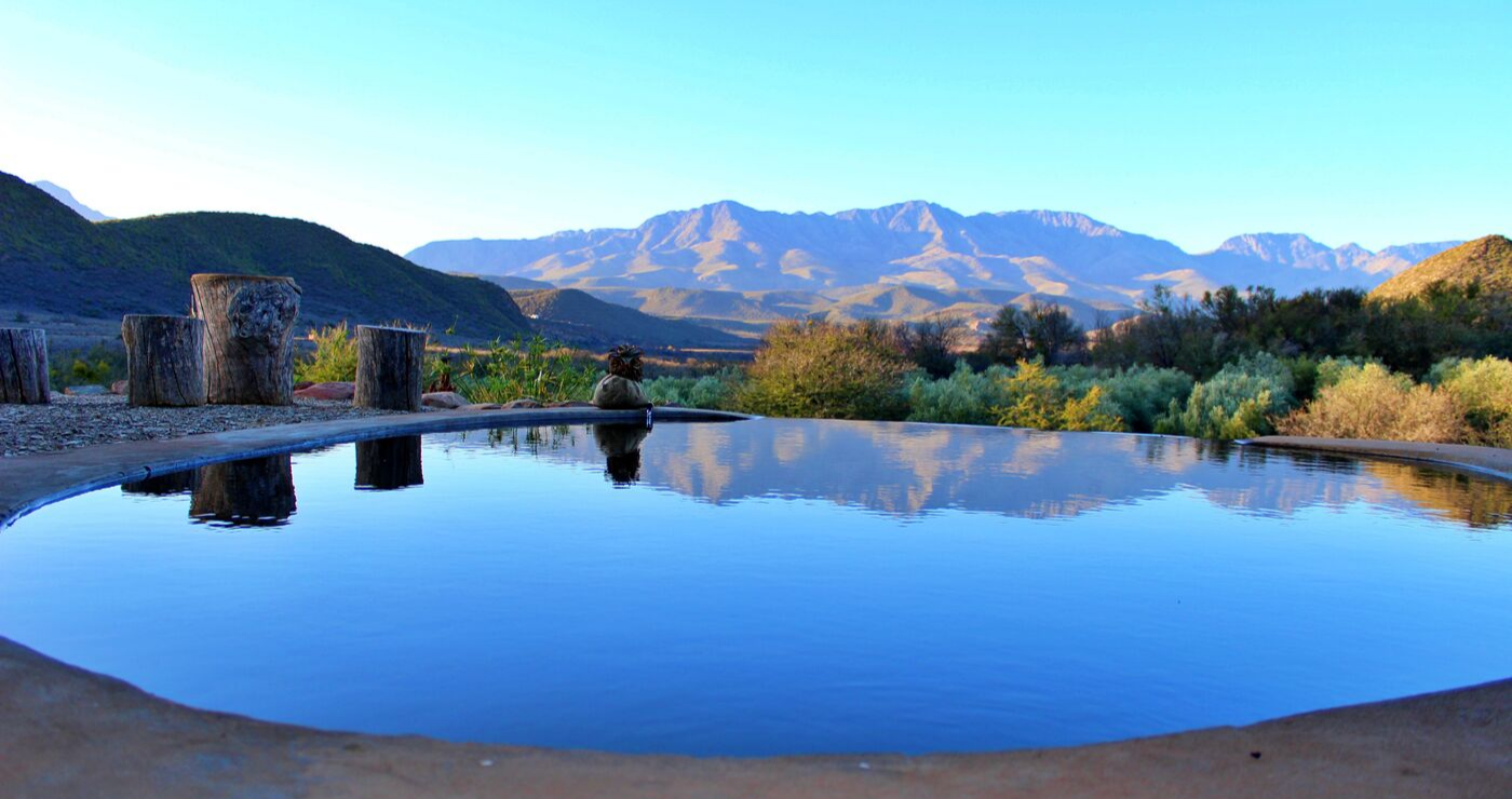 The private, flower-filtered pool offers a view of the mountains.